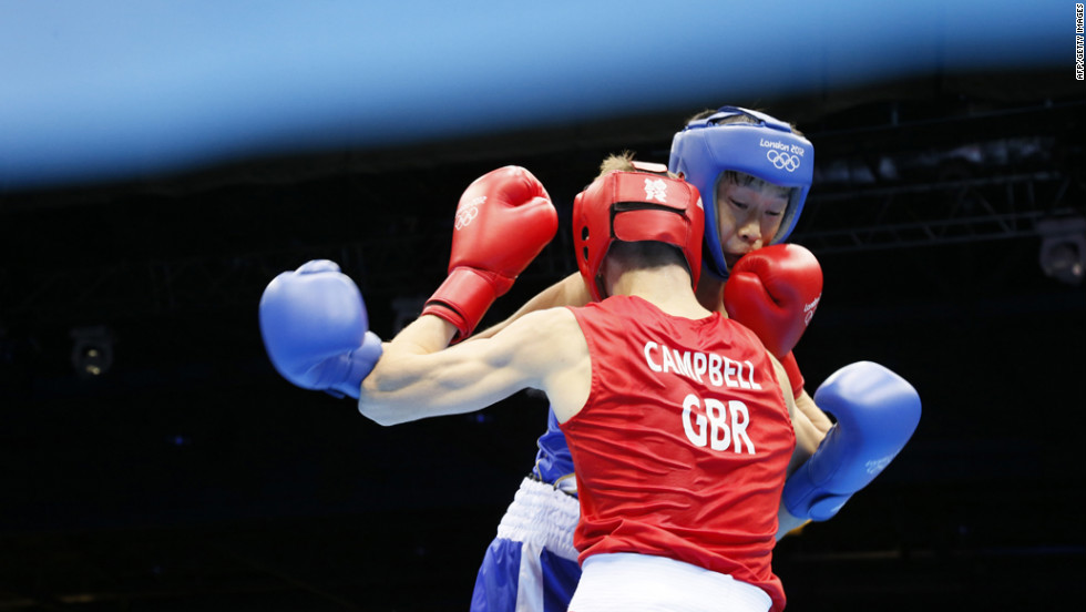 Great Britain's Luke Campbell, left, defends against Satoshi Shimizu of Japan during the men's bantamweight (56-kilogram) boxing semifinals.