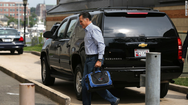 Mitt Romney arrives at his campaign headquarters Friday in Boston.