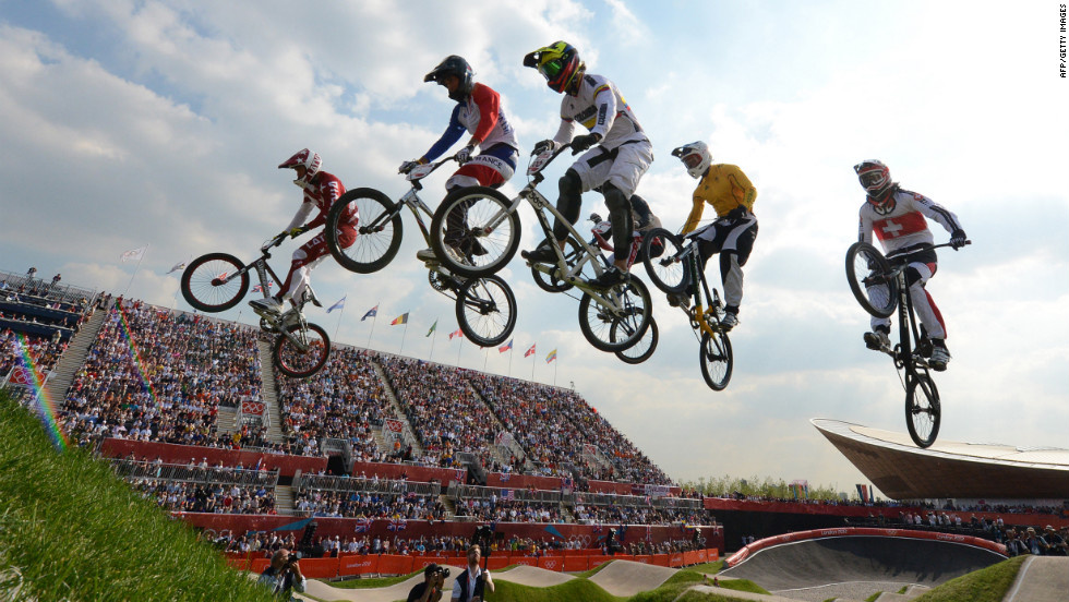 From left, Latvia's Maris Strombergs, France's Joris Daudet, Colombia's Carlos Mario Oquendo Zabala, Australia's Sam Willoughby and Switzerland's Roger Rinderknecht take a jump during the BMX cycling men's semifinal.