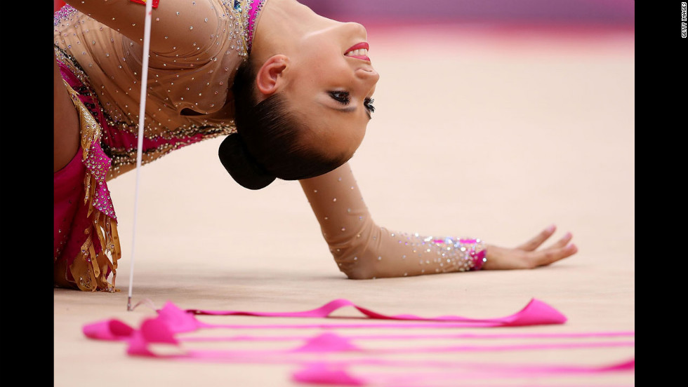 Russian gymnast Daria Dmitrieva performs in the rhythmic gymnastics individual all-around competition.
