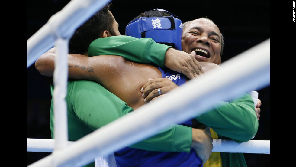 Brazil's Esquiva Falcao Florentino is greeted by his corner after his match against Great Britain's Anthony Ogogo in the men's middleweight boxing semifinals.
