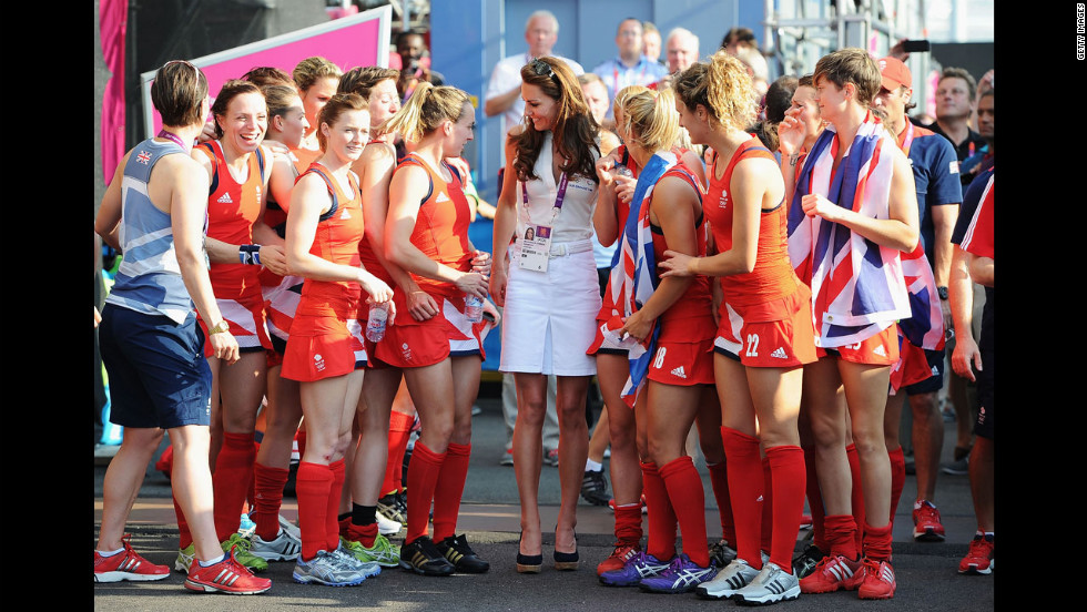 Catherine, Duchess of Cambridge, center, talks to Great Britain's field hockey team members after they won the bronze medal against New Zealand.