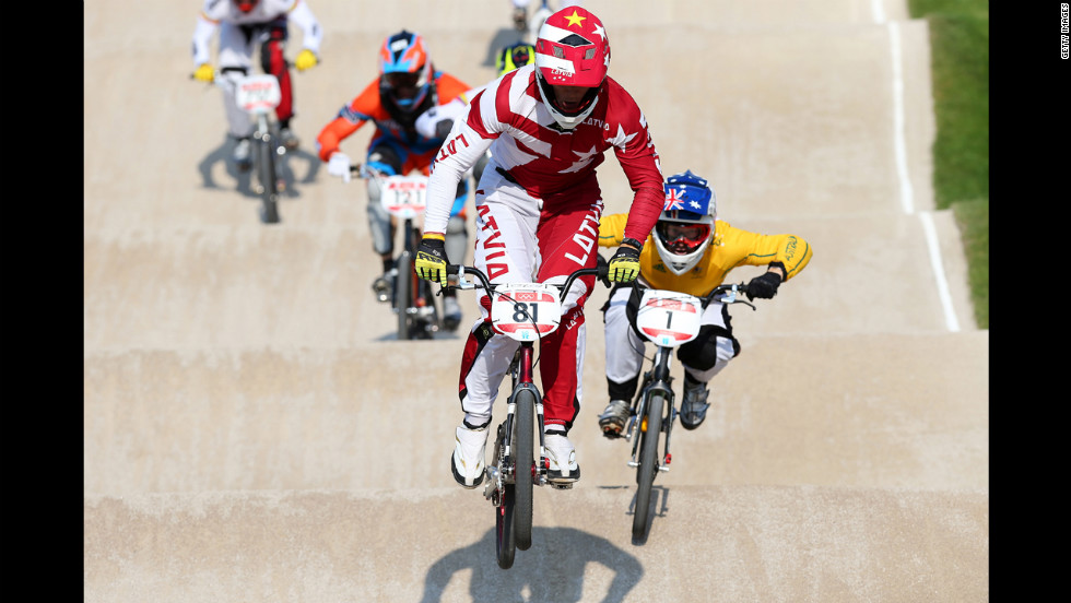 Maris Strombergs of Latvia leads the field in the men's BMX cycling final.