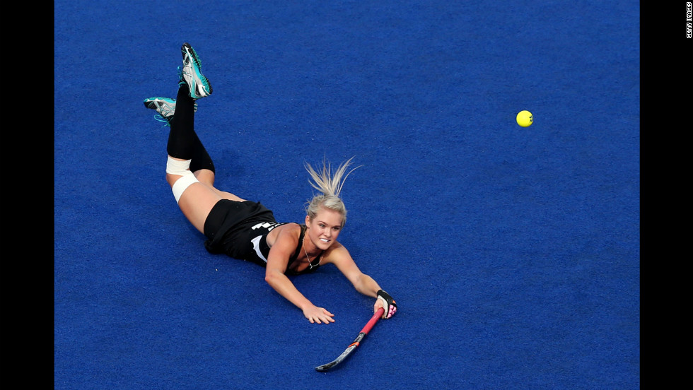 Samantha Harrison, No. 20 of New Zealand, dives after the ball in the second half against Great Britain during the women's hockey bronze medal match.