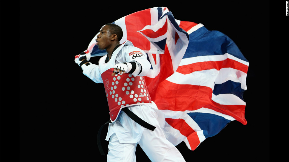 Lutalo Muhammad of Great Britain celebrates winning the bronze medal in the men's 80 kilogram tae kwon do against Arman Yeremyan of Armenia.
