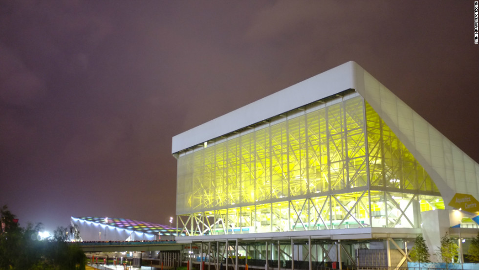 The Aquatic Centre with the Water Polo Arena in the background. From this angle, the Arena almost looked like a blue whale rising up from the Lea. The lights in its roof pulsed from blue to green to purple.