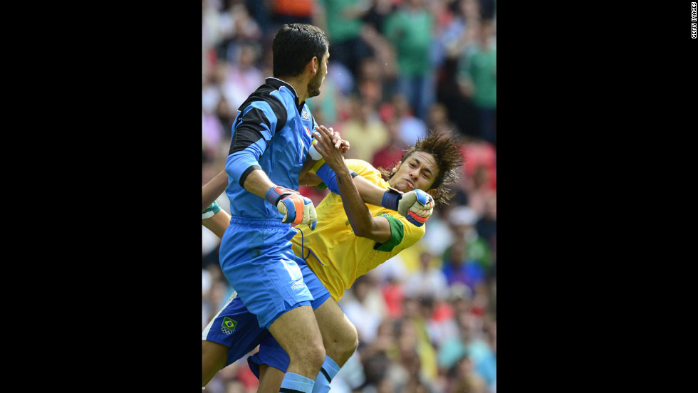 Brazil's forward Neymar da Silva Santos Junior, known as Neymar, right, clashes with Mexico's goalkeeper Jose Corona during the men's football final match.