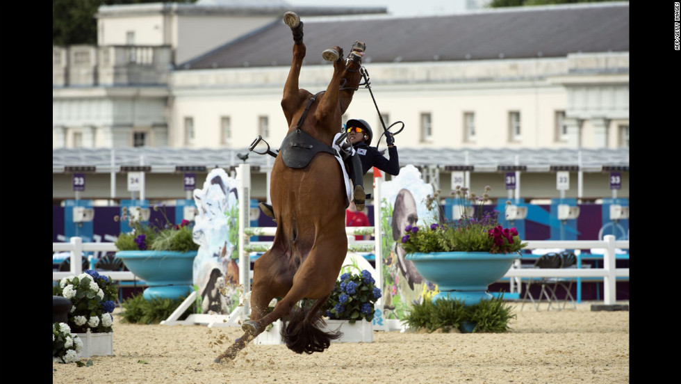 South Korea's Woojin Hwang loses control of his horse during the show jumping event of the modern pentathlon.