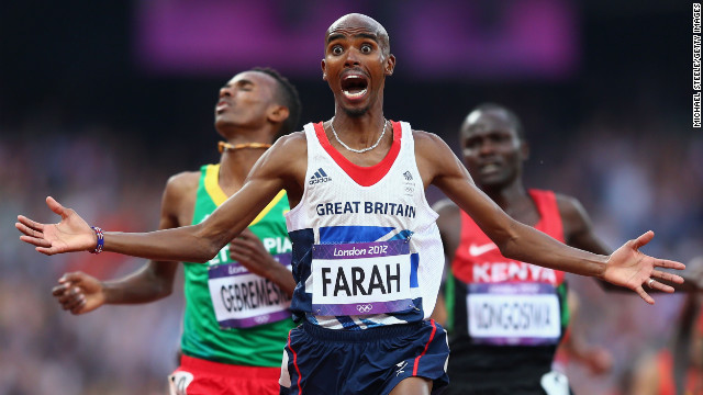 Mo Farah crosses the line has he wins gold for Great Britain in the 10000 meters