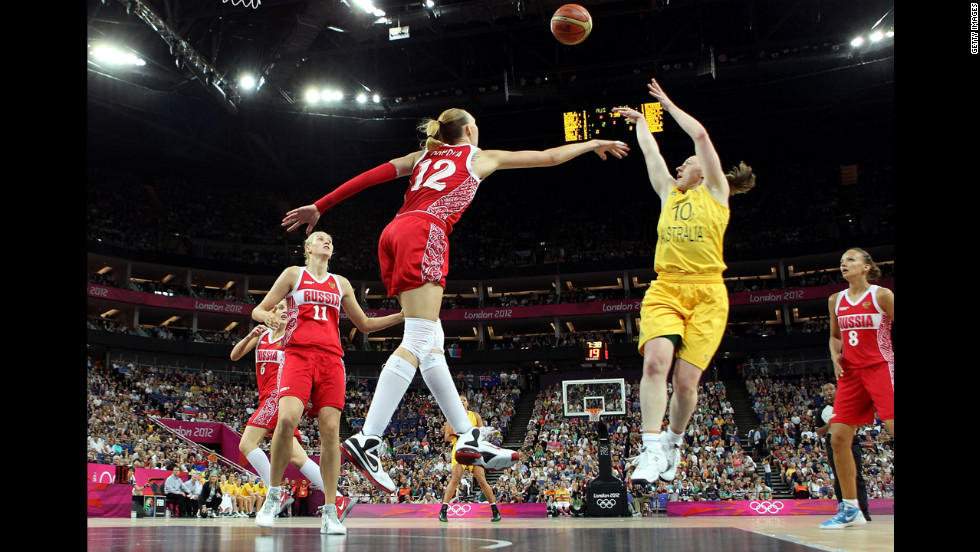 No. 10 Kristi Harrower, of Australia, attempts a shot in the first half against No. 12 Irina Osipova, of Russia, during the women's basketball bronze medal game.