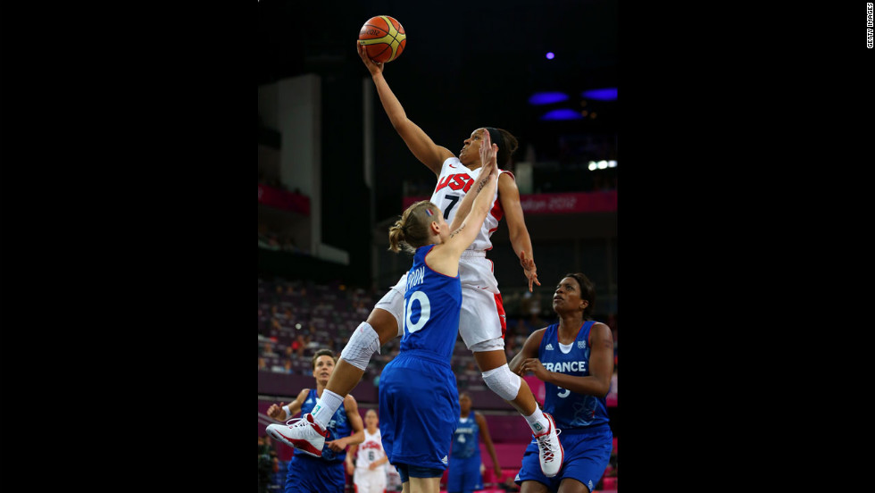 Maya Moore, in white, goes up for a shot against France's Florence Lepron during the gold medal game in London 2012.
