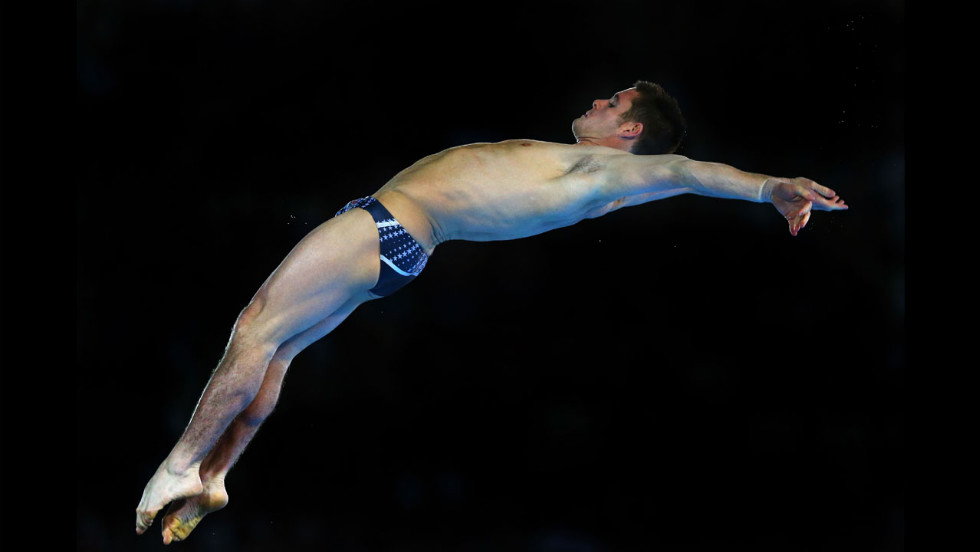 American David Boudia performs a dive in the the men's 10-meter platform diving final. He won gold with China's Bo Qiu taking silver and Great Britain's Tom Daley winning bronze.