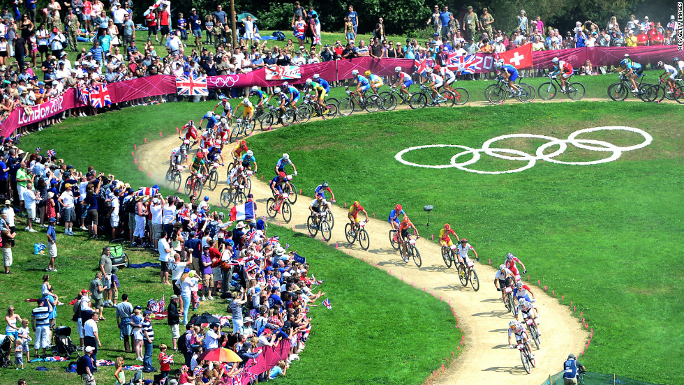 Cyclists speed through the course during the men's cycling cross-country mountain bike race at Hadleigh Farm.