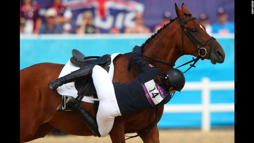 Tamara Vega of Mexico riding Douce de Roulad from her mount in the women's modern pentathlon.