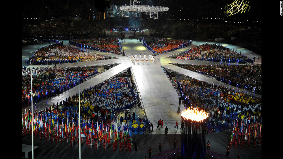 Athletes gather in the center of the stadium to form a giant, living rendition of the British Union Jack.