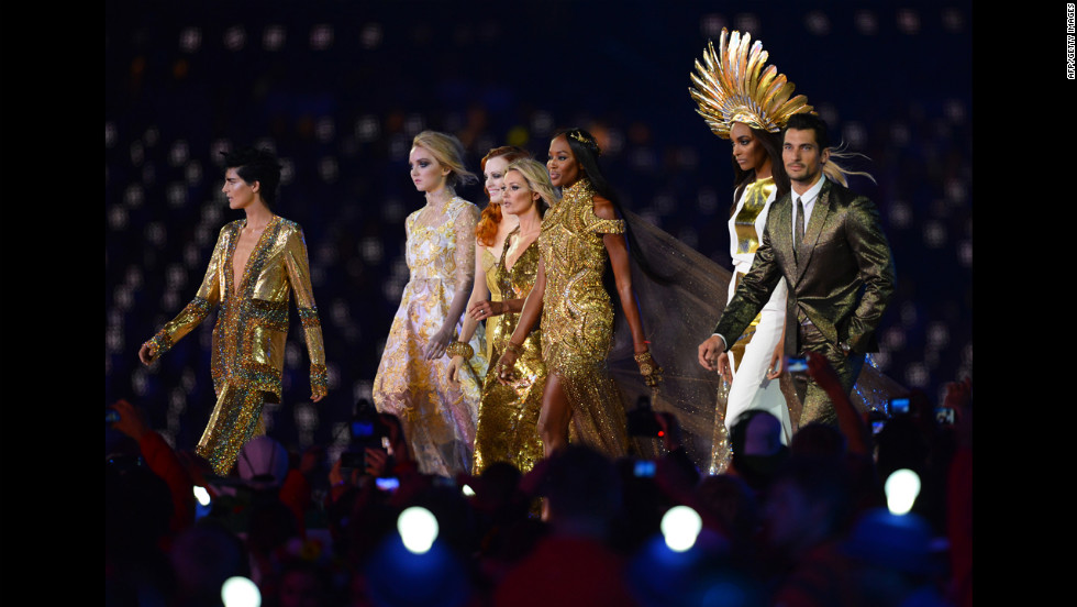 From left, British models Stella Tennant, Lily Cole, Karen Elson,  Kate Moss,  Naomi Campbell,  Jourdan Dunn and David Gandy perform at the Olympic stadium.
