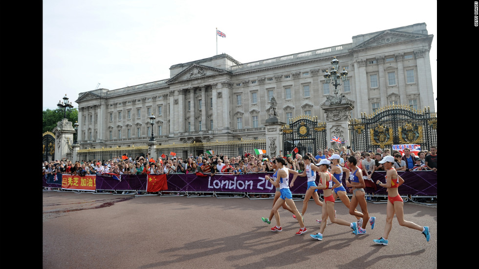 Race walkers compete in front of Buckingham Palace during the Women's 20 km Walk final.