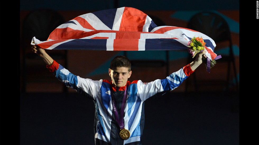 Gold medalist Luke Campbell of Great Britain celebrates with the British national flag during the awards ceremony for the Bantamweight (56kg) boxing category.