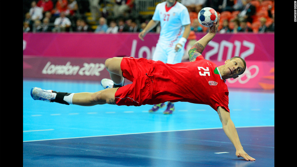 Hungary's pivot Szabolcs Zubai dives and takes a shot during the men's bronze medal handball match against Croatia.