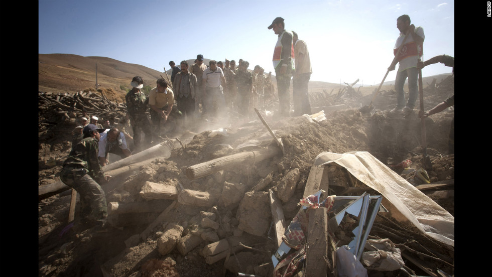 Rescuers search for survivors after an earthquake in Varzaqan, Iran, on Sunday.