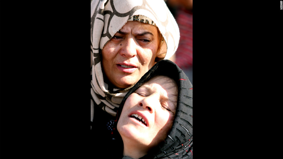 An Iranian woman cries after the earthquake.