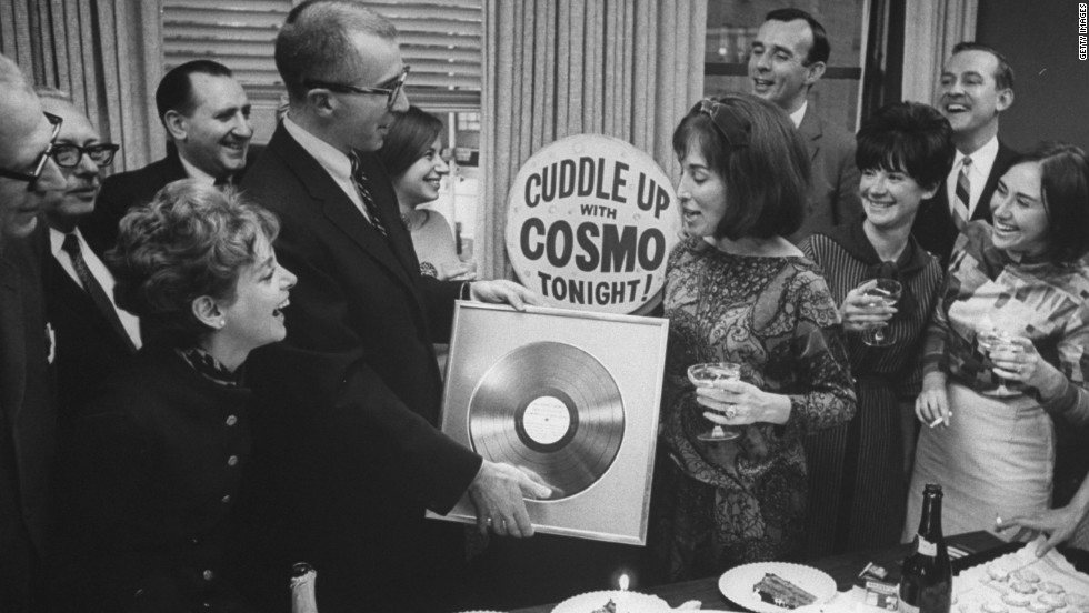 Staffers present Gurley Brown with a gold record at a champagne party celebrating Cosmopolitan's millionth copy in October 1965.
