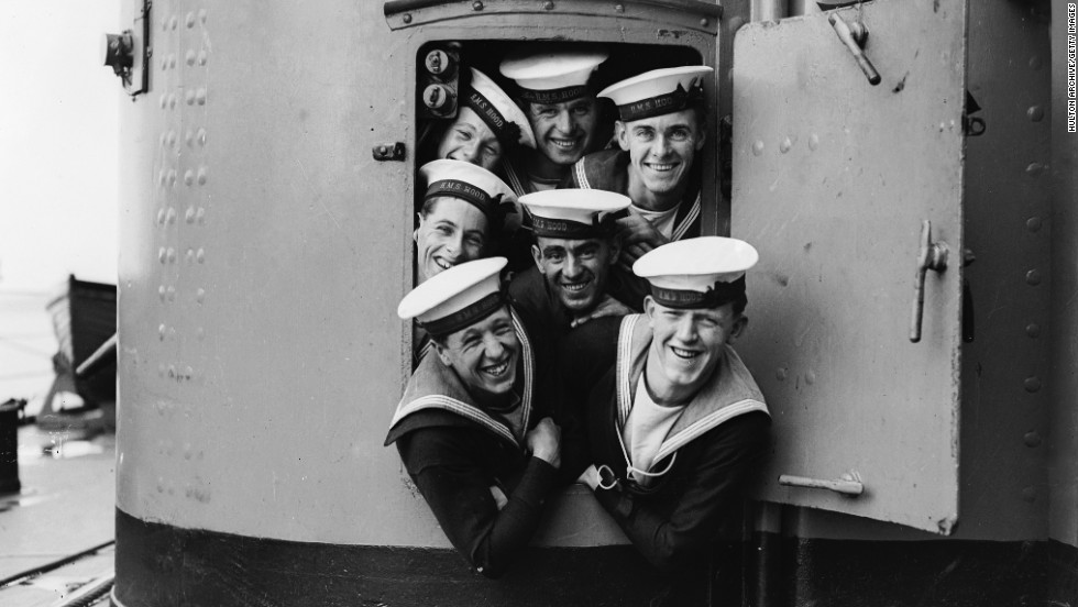 September 1928: A group of sailors on the HMS Hood in high spirits during naval maneuvers.