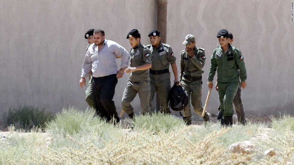 Jordanian security officers detain a Syrian man after he tried to escape from the Zaatari refugee camp in Mafraq.