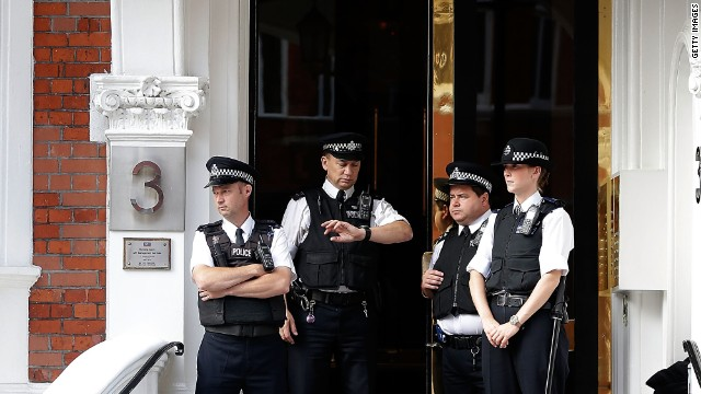 Police stand guard outside the embassy. Britain says it has a legal obligation to extradite Julian Assange.