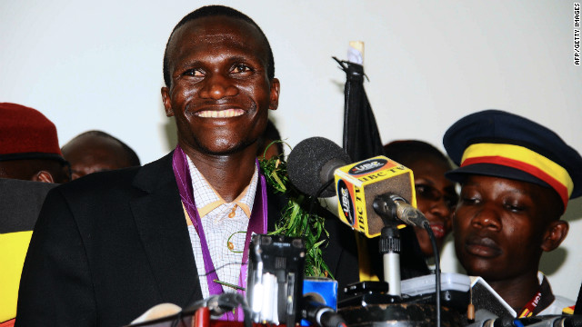 Ugandan Olympics marathon gold winner Stephen Kiprotich smiles during a press conference on arrival at Entebbe International Airport on August 15, 2012.