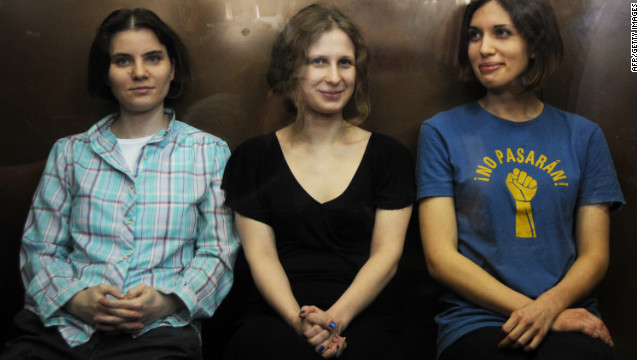 Members of the all-girl punk band 'Pussy Riot' sit in a glass-walled cage during a court hearing in Moscow on August 17, 2012.
