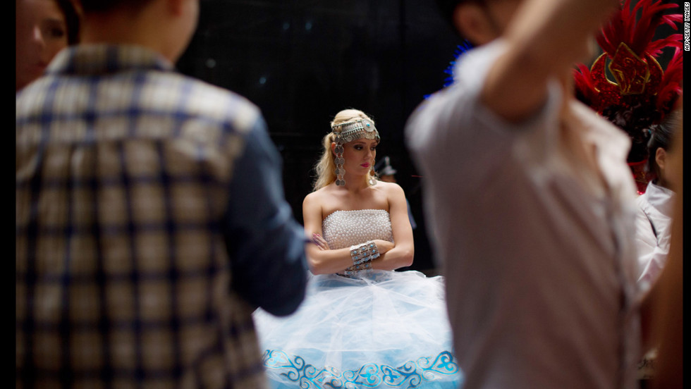 Kazakhstan's Evgeniya Klishina, a Miss World contestant, waits backstage prior to a rehearsal for the final ceremony.