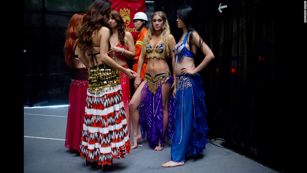 Miss World contestants wait backstage prior to a rehearsal for the final ceremony.
