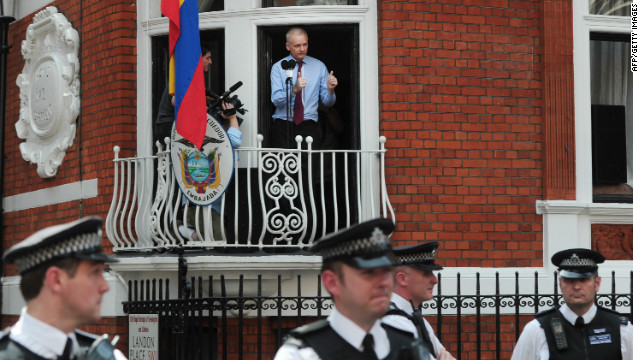"Wikileaks founder Julian Assange gives two thumbs up to the media and his supporters from the balcony of the Ecuadorian Embassy in London on August 19, 2012. Julian Assange praised the ""courage"" shown by the South American nation's president for granting him asylum."