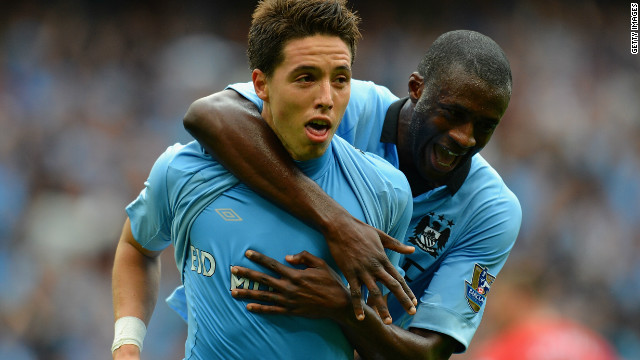 Samir Nasri is congratulated by Yaya Toure after scoring the winning goal for Manchester City at the Etihad Stadium.