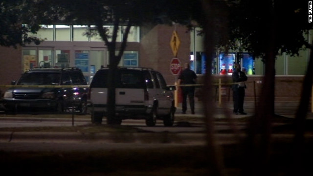 Police investigate the scene of a shooting on Sunday at a parking lot in Cedar Park, Texas.