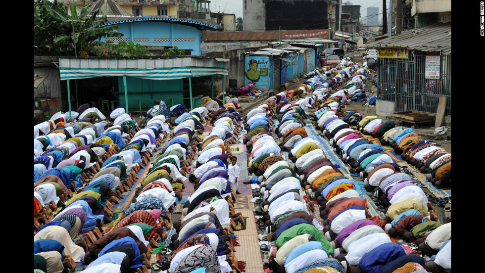 Muslims pray outside a mosque as they mark the start of Eid al-Fitr in the Adjame district of Abidjan, Ivory Coast, on Sunday.