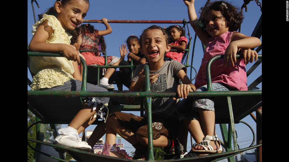 Palestinian children enjoy a ride in a park on the second day of Eid al-Fitr on Monday.