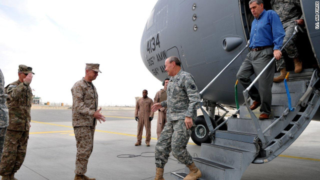 Gen. Martin Dempsey (C) is welcomed to Afghanistan.  The plane he arrived in was later hit by shrapnel from two rockets.
