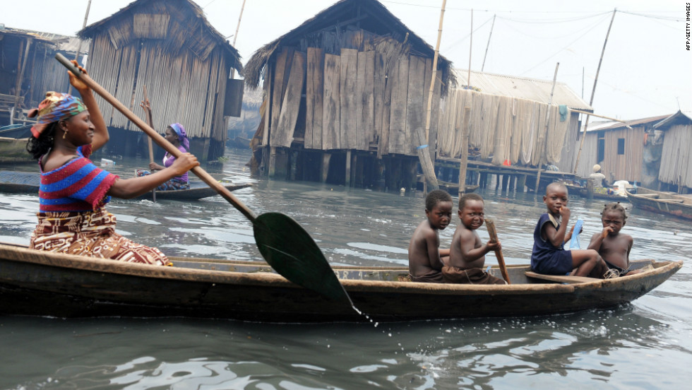 A mother paddles her canoe through a waterway in Makoko. The population explosion in Lagos has resulted to unprecedented demand for land.