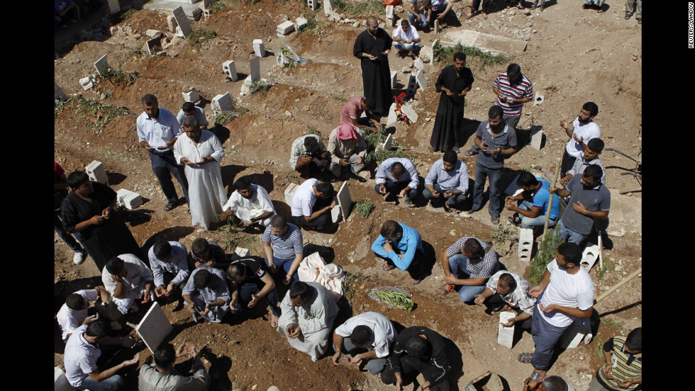 People pray during the funeral of the Free Syrian Army fighter, Amar Ali Amero on August 21.