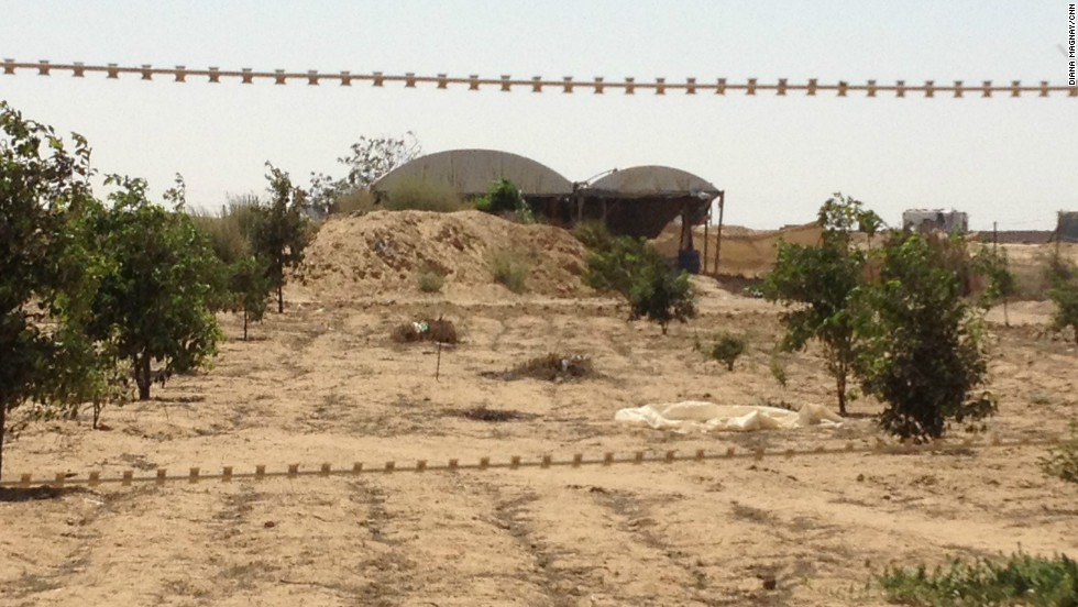 Behind barbed wire are the entrances to the Gaza-Egypt smuggling tunnels - a key trade route for Hamas-controled Gaza.
