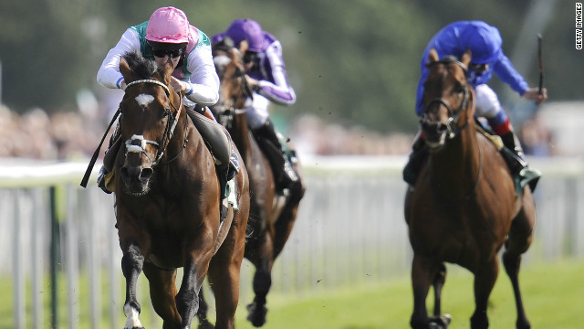 Frankel and jockey Tom Queally burst clear to win the Juddmonte International at York in commanding fashion.