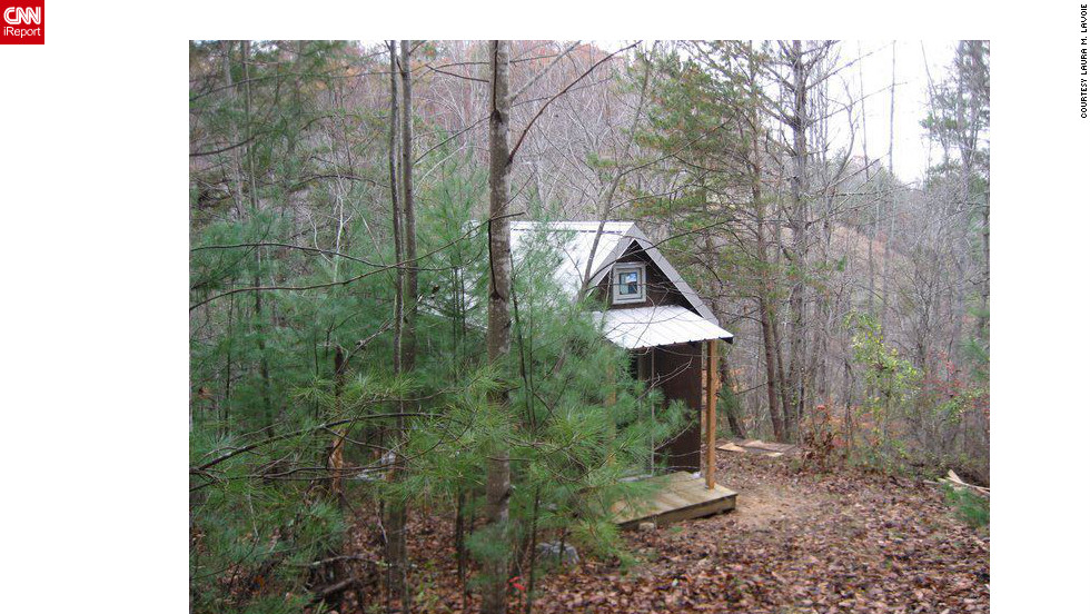 "Realizing that their 2,700-square-foot home was becoming too much of a maintenance burden, Laura M. LaVoie and her partner decided to dramatically downsize to a 120-square-foot home in a remote area of North Carolina. ""Tiny house living isn't for everyone,"" she said. ""But living differently will profoundly change you no matter how you do it."""