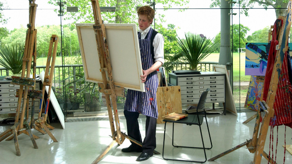 Prince Harry paints in Eton College's new Drawing Room on May 12, 2003.
