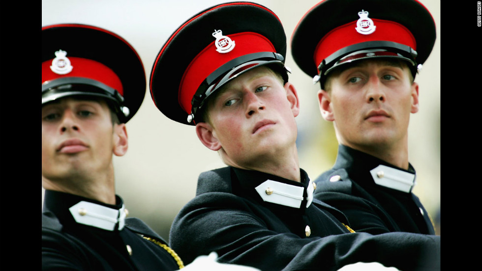 Prince Harry takes part in the Trooping Of New Colours alongside his fellow officer cadets at the Royal Military Academy on June 21, 2005, in Sandhurst, England.