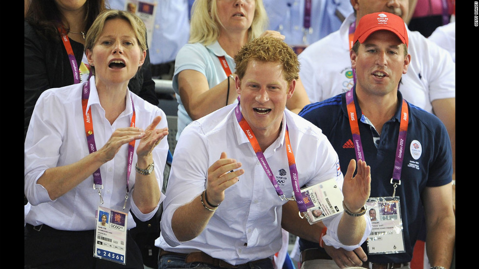 Left to right: Carole Coe, Prince Harry and Peter Phillips enjoy the atmosphere as they watch track cycling at the Velodrome on August 7, 2012 at the London 2012 Olympic Games.
