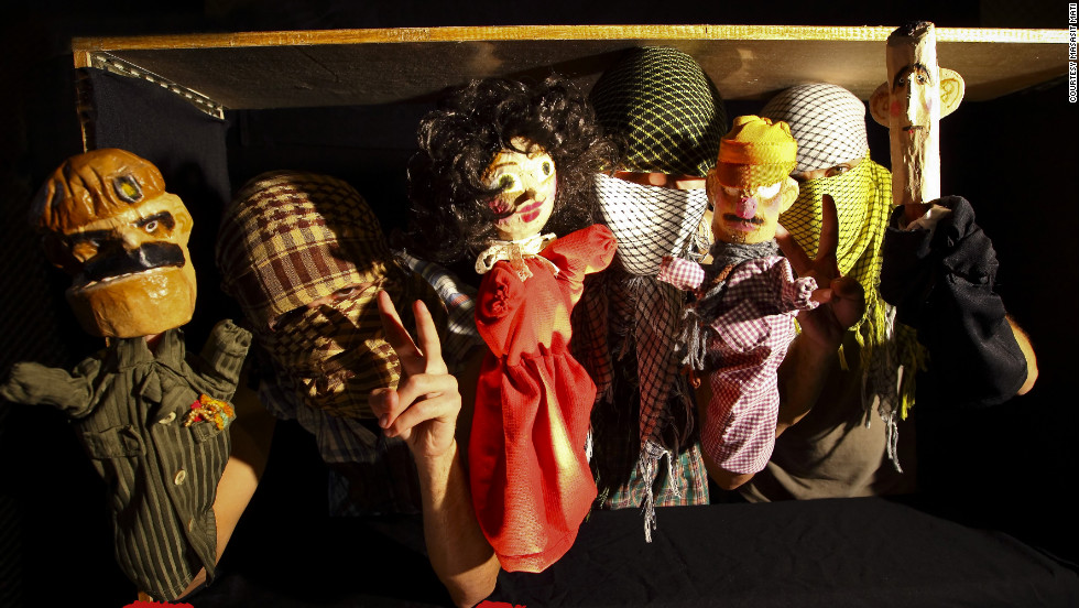"The puppet cast of ""Top Goon: Diaries of a Little Dictator,"" produced by anonymous Syrian artists' collective Masasit Mati. At the far right is the character representing Assad, known by the diminutive ""Beeshu."""