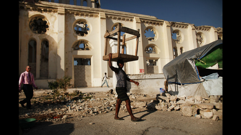 People walk near a cathederal destroyed by the earthquake in Port-au-Prince.