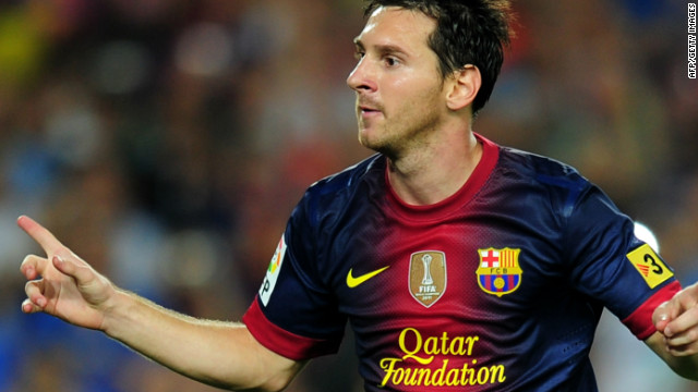 Lionel Messi celebrates scoring from the penalty spot in Barcelona's 3-2 Spanish Super Cup win over Real Madrid.
